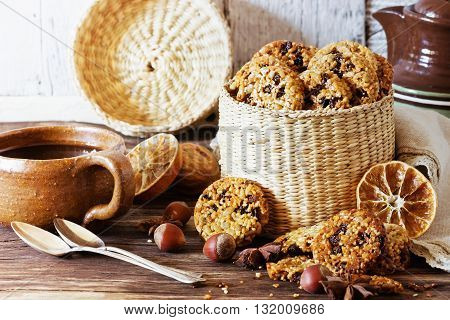 Homemade cookies from sesame seeds raisins and caramel in a basket on a wooden table. Selective focus