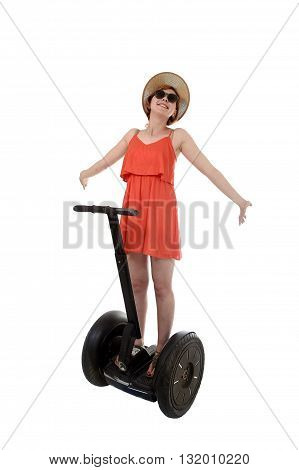 young attractive tourist woman in chic summer dress smiling happy riding electrical segway having fun hands free driving isolated on white background in ecological transport concept