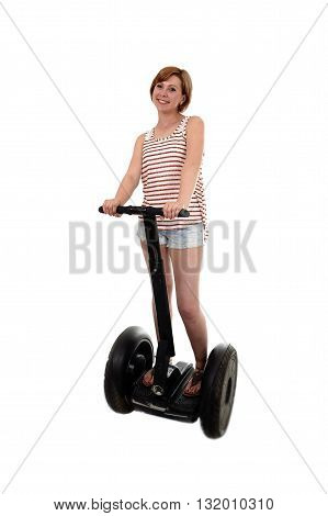 young attractive tourist woman with red hair wearing summer shorts smiling happy riding electrical segway having fun driving isolated on white background in ecological transport concept