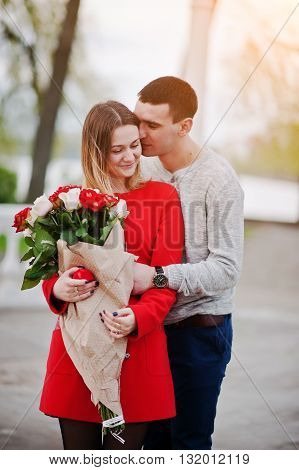 Marriage Proposal. Hugging Loved Couple With Bouquet Of Rose