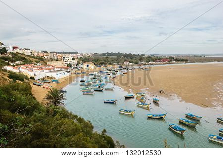 Panoramic view over the lagoon with fisher boats at Moulay Bousselham, Morocco, Africa