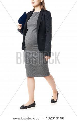 Businesswoman waiting for baby holding folder.Studio shot.Isolated