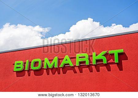 Heidenheim, Germany - May 26, 2016: Organic food market / bio market, red facade labeled with