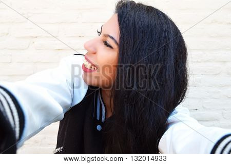 Young Latin Woman Taking A Selfie