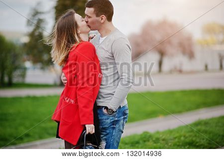 Kissed and huqqing couple in love outdoor