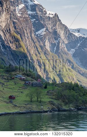 Traditional Norwegian houses on the banks of the Geirangerfjord