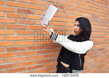 Latin Woman Taking A Selfie With A Tablet