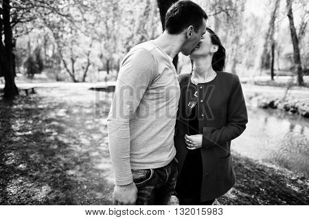 Kissed and huqqing couple in love. Black and white photo