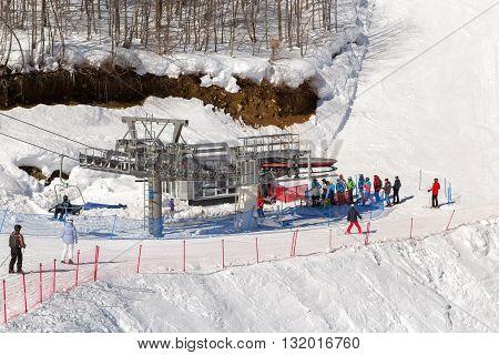 Sochi, Russia - February 10, 2016: Mountain lift in ski resort Rosa Khutor in Krasnaya Polyana - popular center of skiing and snowboard