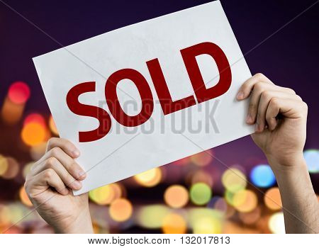 Sold placard with bokeh background