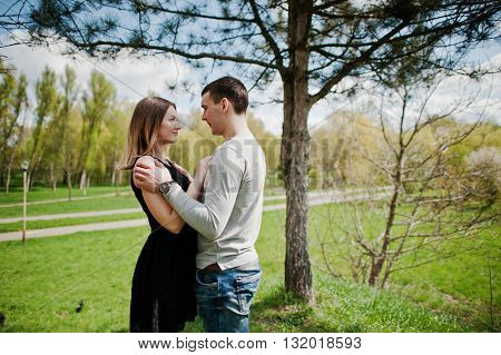 Happy Romantic Couple In Love Stay Near Tree And Hugging