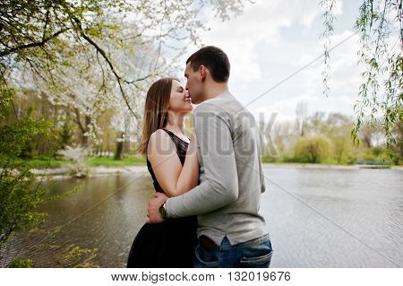 Young Couple In Love Outdoor. Boy Kiss Nose Of His Girl