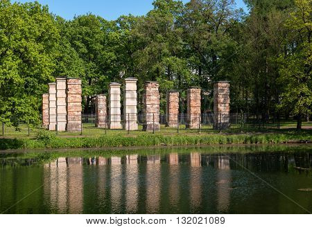 Admiralty ruins reflected in the lake. Palace Park of Gatchina. The building is intended for storage of sailing and rowing boats.