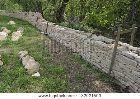 New Cotswold Limestone Dry Stone Wall under construction