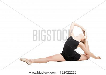 Ballet dancer in split bending back on white background