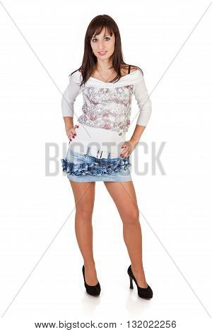 Pretty brunette woman in sexy mini skirt on white background