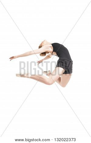 Unrecognizable blonde ballet dancer in ballet shoes jumping