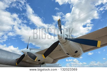 Close up of propellers of airplane and in blue sky with clouds