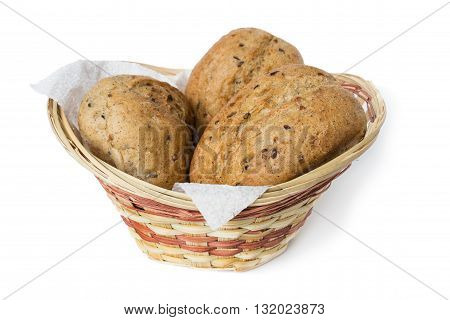 Three oatmeal buns in a small basket on a white background