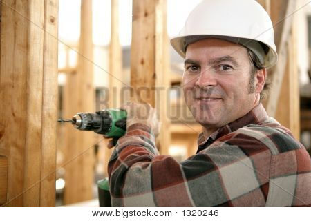 Carpenter Drilling Wood