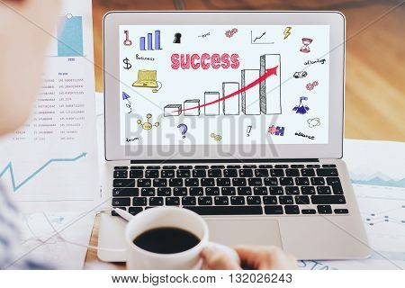 drawing success chart on screen laptop close up