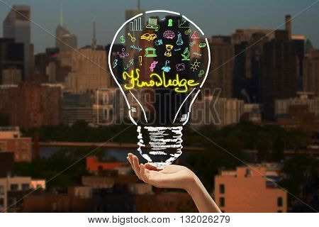 hand holding drawing lamp. knowledge concept. 3D Rendering