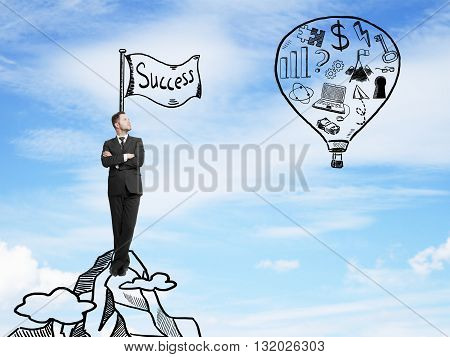 businessman looking on balloon with drawing business symbol. success concept