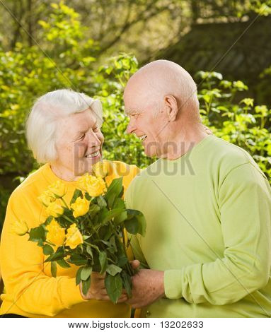 Happy senior couple in love outdoors