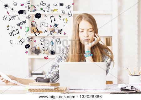 girl sitting in office and using laptop