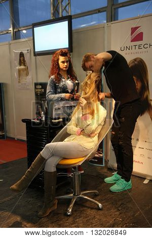 BELGRADE SERBIA-APRIL 27:Hairdress modeling at 27th international fair and congress of cosmetics The touch of Paris April 272016 in Belgrade Serbia