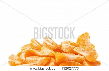 Pile of slice sections of fresh peeled tangerine isolated over the white background