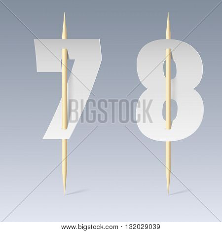 Illustration of white paper cut font on toothpicks on grey background. 7 and 8 numerals