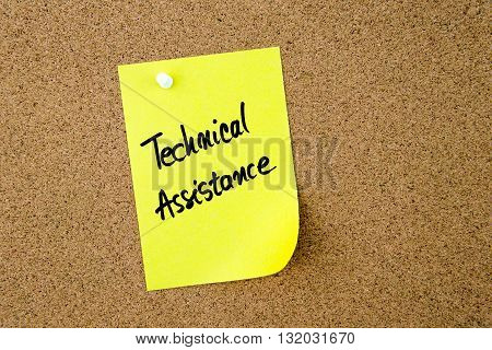 Technical Assistance Written On Yellow Paper Note