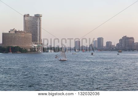 Cairo Egypt - May 26 2016: Felucca boats sailing on the Nile river in central Cairo at dusk.