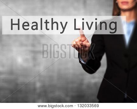 Healthy Living - Businesswoman Hand Pressing Button On Touch Screen Interface.