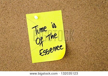 Time Is Of The Essence Written On Yellow Paper Note