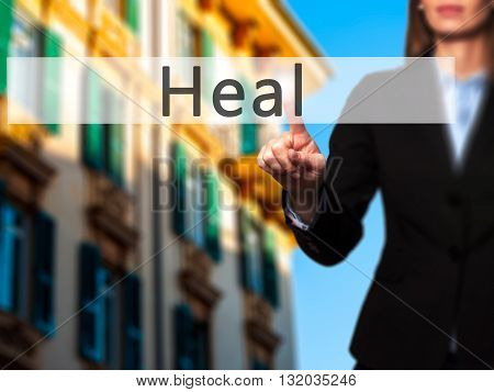 Heal - Businesswoman Hand Pressing Button On Touch Screen Interface.