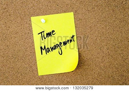 Time Management Written On Yellow Paper Note