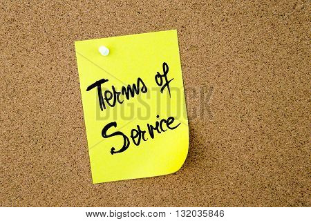 Terms Of Service Written On Yellow Paper Note