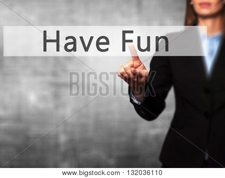 Have Fun - Businesswoman Hand Pressing Button On Touch Screen Interface.