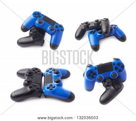 Composition of two gaming console controller gamepad devices, black and blue, isolated over the white background, set of four different foreshortenings