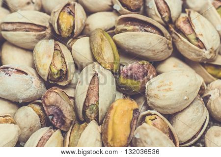Pistachios nuts roasted healthy nutrition organic food fit health macro close up matte selective focus