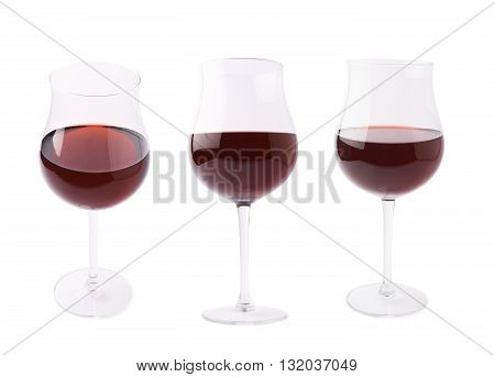 Glass filled with the red wine isolated over the white background, set of three different foreshortenings