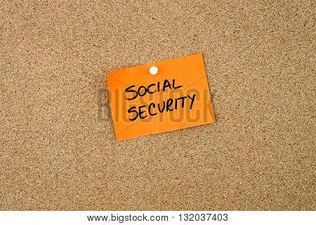 Social Security Written On Orange Paper Note