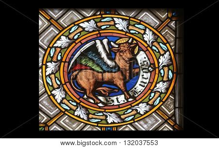 OBERSTAUFEN, GERMANY - OCTOBER 20: Symbols of the Saint Luke the Evangelist, stained glass window in the parish church of St. Peter and Paul in Oberstaufen, Germany on October 20, 2014.