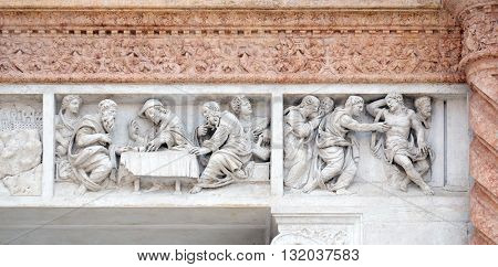 BOLOGNA, ITALY - JUNE 04: Supper at Emmaus left and Doubting Thomas right by Zaccaria da Volterra, door of San Petronio Basilica in Bologna, Italy, on June 04, 2015