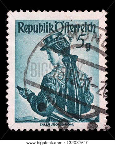 ZAGREB, CROATIA - SEPTEMBER 13: a stamp printed in the Austria shows Woman from Salzburg, Pinzgau, Regional Costume, circa 1949, on September 13, 2014, Zagreb, Croatia
