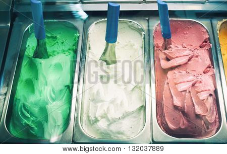 Three flavour green white and red ice-cream in shop close up