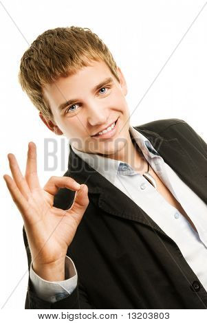 Handsome young man showing ok gesture. Isolated on white background