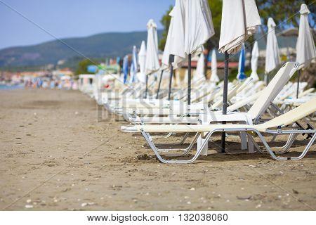 Empty Sun Loungers On The Beach Before Summer Season
